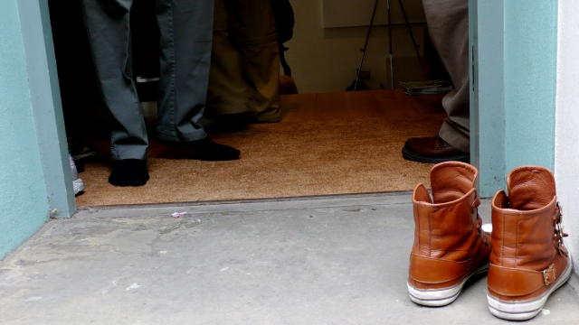 Leaving shoes at the door can signal a transition. Photo courtesy of flickr.